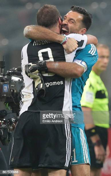 Gianluigi Buffon of Juventus FC celebrates the victory with his teammate Gonzalo Higuain at the end of the Serie A match between AC Milan and...