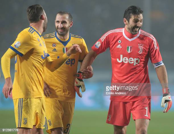 Gianluigi Buffon of Juventus FC celebrates the victory with his teammates Giorgio Chiellini and Andrea Barzagli at the end of the TIM Cup match...