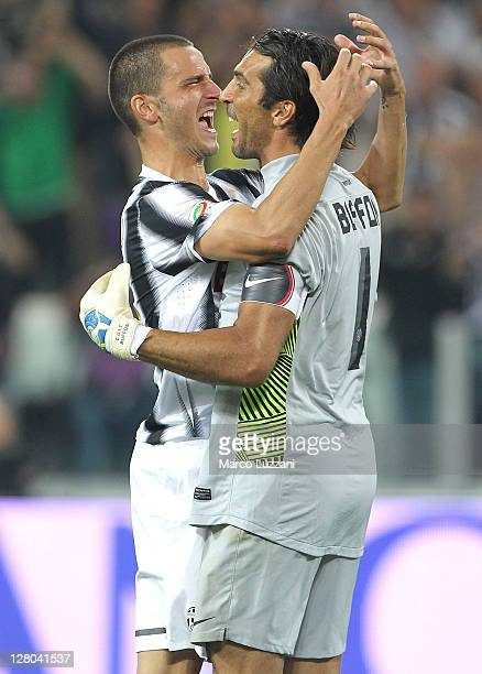 Gianluigi Buffon of Juventus FC celebrates the victory with teammates Leonardo Bonucci at the end of the Serie A match between Juventus FC and AC...