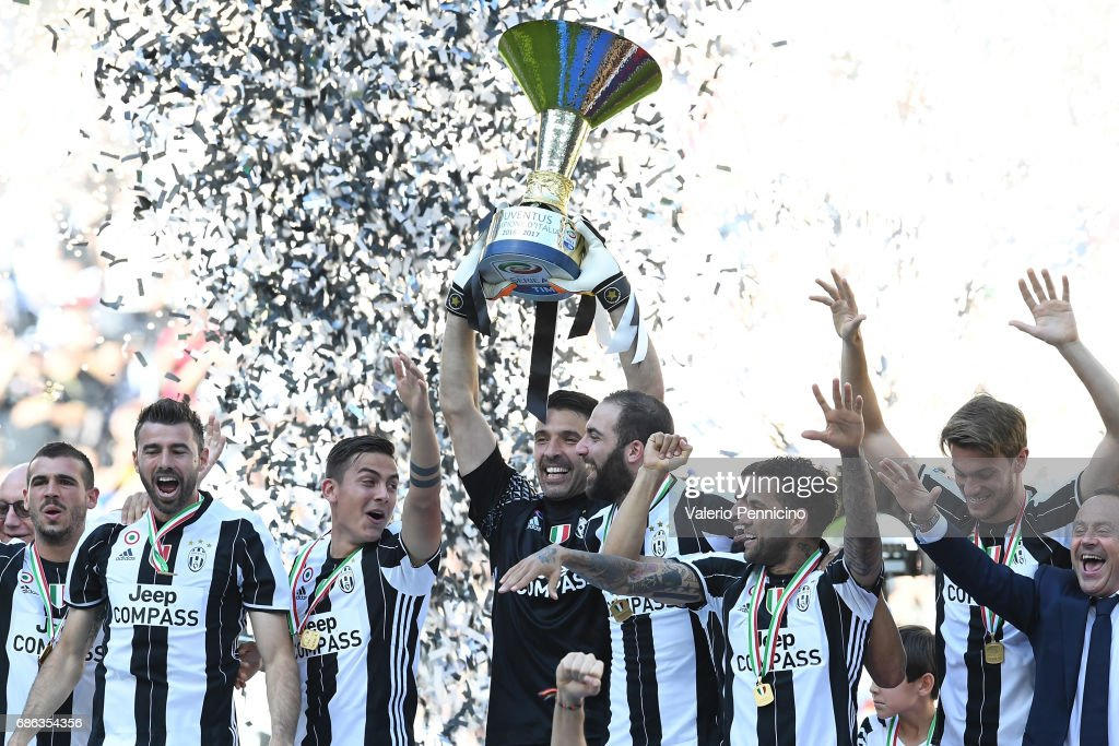 Gianluigi Buffon of Juventus FC celebrates with the trophy after the beating FC Crotone 3-0 to win the Serie A Championships at the end of the Serie A match between Juventus FC and FC Crotone at Juventus Stadium on May 21, 2017 in Turin, Italy.