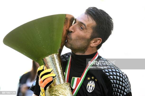 Gianluigi Buffon of Juventus FC celebrates with the trophy after the beating FC Crotone 3-0 to win the Serie A Championships at the end of the Serie...