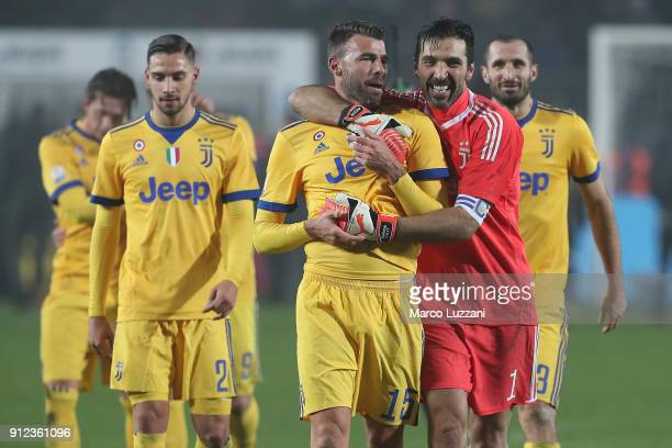 Gianluigi Buffon of Juventus FC embraces his team mate Andrea Barzagli at the end of the TIM Cup match between Atalanta BC and Juventus at Stadio...