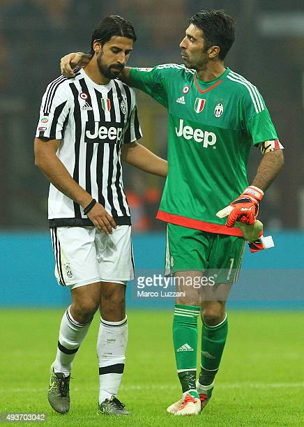 Gianluigi Buffon of Juventus FC embraces his temmate Sami Khedira at the end of the Serie A match between FC Internazionale Milano and Juventus FC at...
