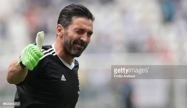 Gianluigi Buffon of Juventus FC greets the fans in his last match for the club prior to the serie A match between Juventus and Hellas Verona FC at...
