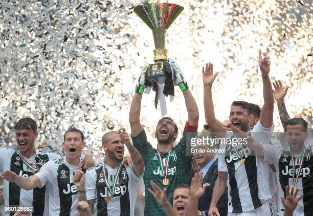 Gianluigi Buffon of Juventus FC lifts the Serie A trophy in his last match for the club as he celebrates winning the championship with team-mates at...