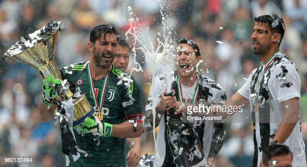 Gianluigi Buffon of Juventus FC lifts the Serie A trophy in his last match for the club as he celebrates winning the championship with teammates at...