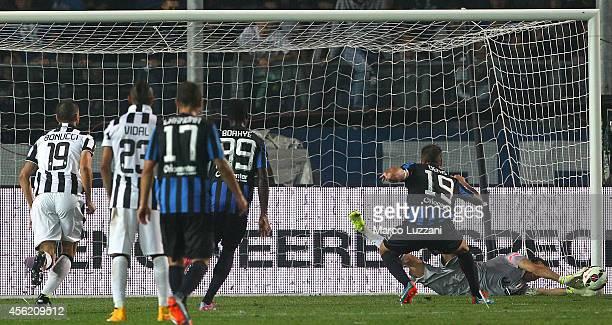 Gianluigi Buffon of Juventus FC saves a penaltykick taken by German Gustavo Denis of Atalanta BC during the Serie A match between Atalanta BC v...
