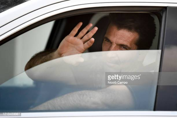 Gianluigi Buffon of Juventus FC waves as he arrives by car to the Continassa training ground to attend a training session Serie A plans to resume its...
