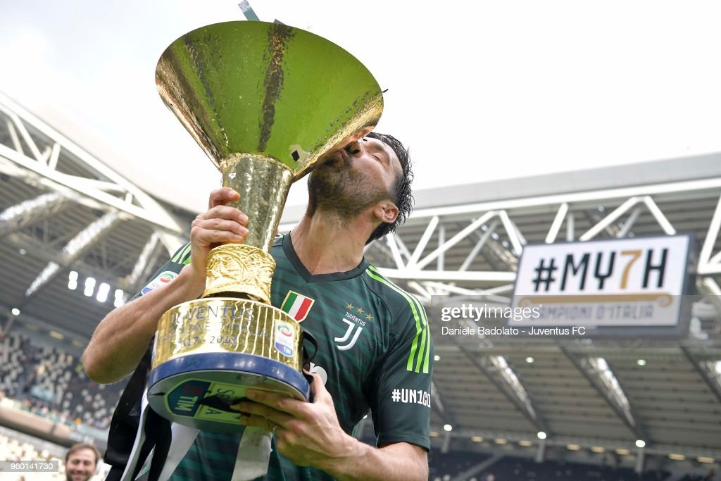Gianluigi Buffon of Juventus holding the trophy after winning the seventh league titles in a row at the end of the serie A match between Juventus and Hellas Verona FC at Allianz Stadium on May 19, 2018 in Turin, Italy.