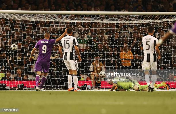 Gianluigi Buffon of Juventus is beaten by the shot of Cristiano Ronaldo of Real Madrid for the opening goal during the UEFA Champions League Final...