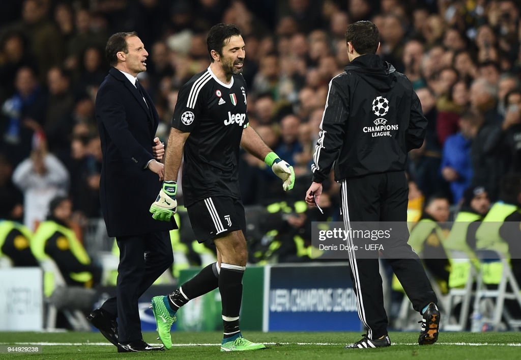 Gianluigi Buffon of Juventus leaves the pitch after been sent off during the UEFA Champions League Quarter Final Second Leg match between Real Madrid and Juventus at Estadio Santiago Bernabeu on April 11, 2018 in Madrid, Spain.