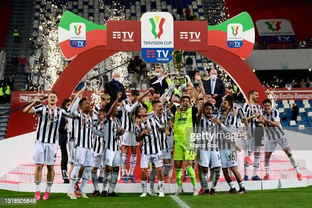 Gianluigi Buffon of Juventus lifts the TIMVISION Cup Final during the TIMVISION Cup Final between Atalanta BC and Juventus on May 19, 2021 in Reggio...