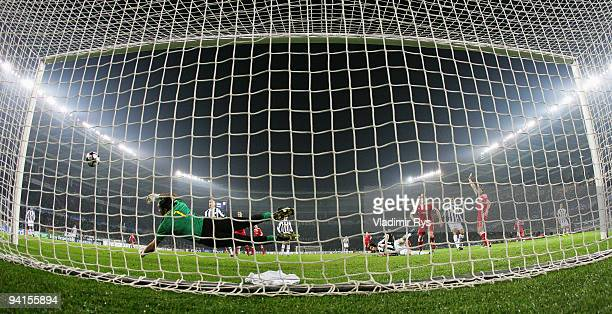 Gianluigi Buffon of Juventus looks behind the ball hitting the post after a header from Ivica Olic of Bayern during the UEFA Champions League Group A...