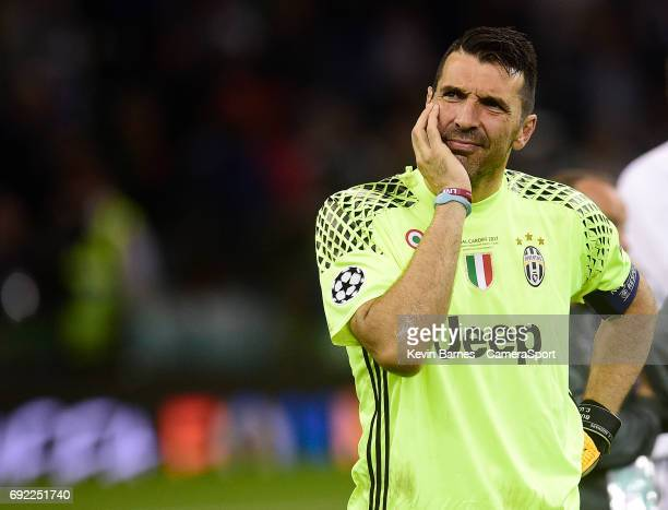 Gianluigi Buffon of Juventus looks dejected after his sides defeat during the UEFA Champions League Final match between Juventus and Real Madrid at...