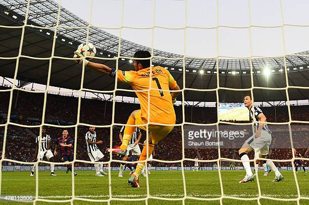Gianluigi Buffon of Juventus makes a save during the UEFA Champions League Final between Juventus and FC Barcelona at Olympiastadion on June 6, 2015...