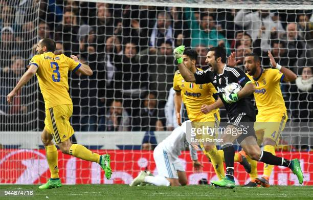 Gianluigi Buffon of Juventus reacts after a penalty is awarded to Real Madrid during the UEFA Champions League Quarter Final Second Leg match between...