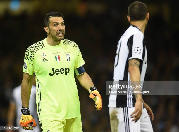 Gianluigi Buffon of Juventus remonstrates with Leonardo Bonucci after a Real Madrid chance during the UEFA Champions League Final match between...