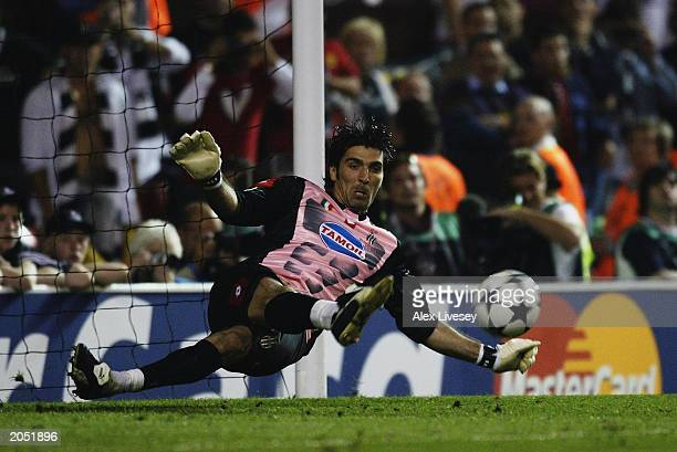 Gianluigi Buffon of Juventus saves a penalty during the penalty shoot out during the UEFA Champions League Final match between Juventus FC and AC...