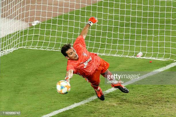 Gianluigi Buffon of Juventus saves the ball during the penalty shot out during the International Champions Cup match between Juventus and FC...