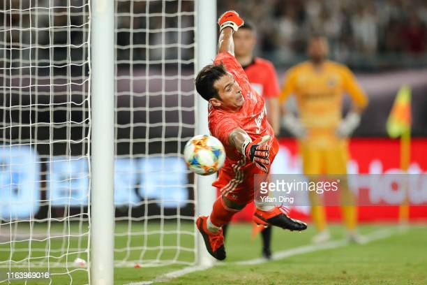 Gianluigi Buffon of Juventus tries to save a goal during penalty shootout of the International Champions Cup match between Juventus and FC...