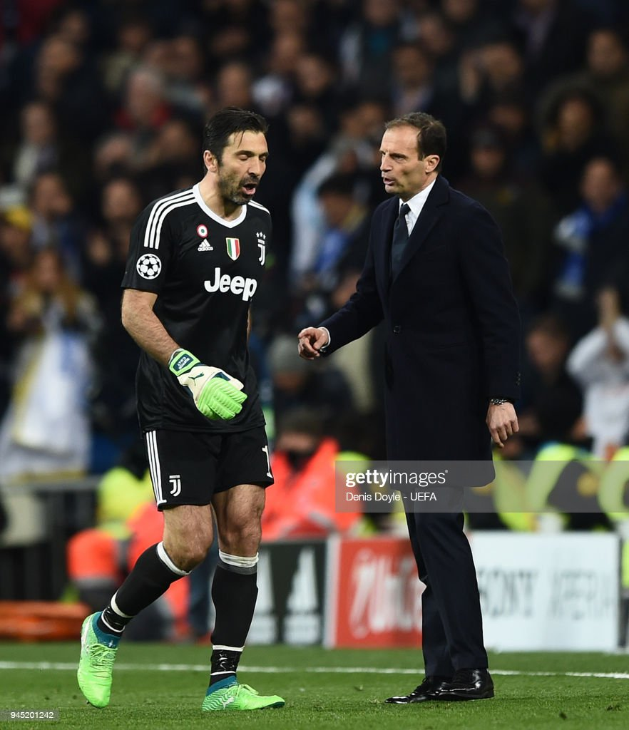 Gianluigi Buffon of Juventus walks past his manager Massimiliano Allegri after been sent off during the UEFA Champions League Quarter Final Second Leg match between Real Madrid and Juventus at Estadio Santiago Bernabeu on April 11, 2018 in Madrid, Spain.