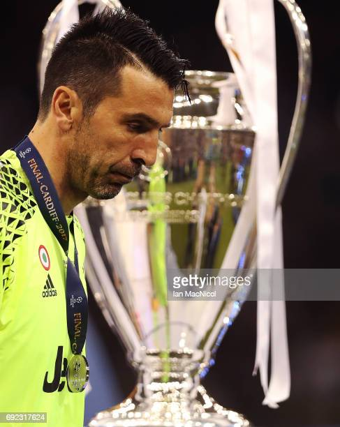 Gianluigi Buffon of Juventus walks past the trophy during the UEFA Champions League Final between Juventus and Real Madrid at National Stadium of...