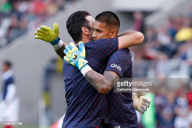 Gianluigi Buffon of Paris SaintGermain gives a hug to Alphonse Areola of Paris SaintGermain during the Ligue 1 match between Stade de Reims and Paris...