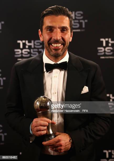Gianluigi Buffon poses with his award after being included in the team of the year during The Best FIFA Football Awards at The London Palladium on...