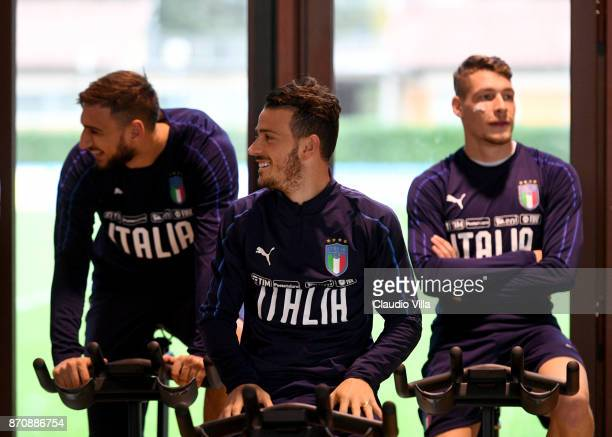Gianluigi Donnarumma Alessandro Florenzi and Andrea Belotti of Italy chat during a training session at Italy club's training ground at Coverciano on...