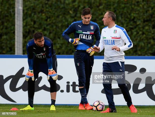 Gianluigi Donnarumma Alex Meret and Goalkeeper Coach Gianluca Spinelli chat during the training session at the club's training ground at Coverciano...