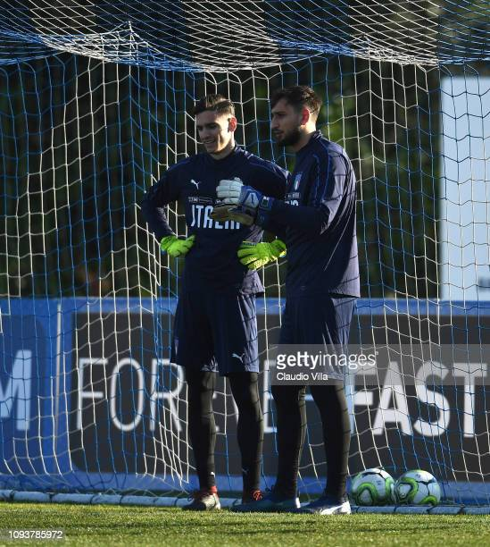 Gianluigi Donnarumma and Alex Meret of Italy chat during a training session at Centro Tecnico Federale di Coverciano on February 4 2019 in Florence...
