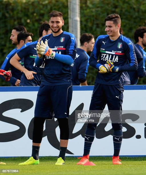 Gianluigi Donnarumma and Alex Meret of Italy chat during the training session at the club's training ground at Coverciano on March 25 2017 in...