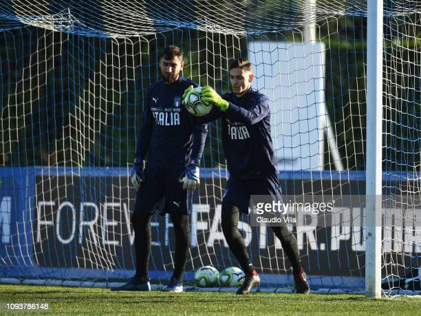 Gianluigi Donnarumma and Alex Meret of Italy in action during a training session at Centro Tecnico Federale di Coverciano on February 4 2019 in...