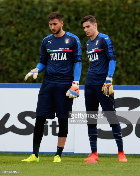 Gianluigi Donnarumma and Alex Meret of Italy look on during the training session at the club's training ground at Coverciano on March 25 2017 in...
