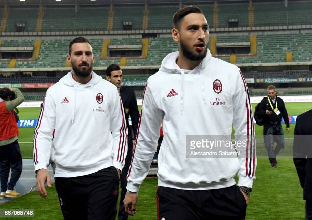 Gianluigi Donnarumma and Antonio Donnarumma of AC Milan looks on before the Serie A match between AC Chievo Verona and AC Milan at Stadio...
