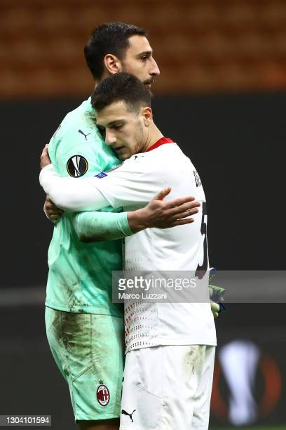 Gianluigi Donnarumma and Diogo Dalot of A.C. Milan celebrate following the UEFA Europa League Round of 32 match between AC Milan and Crvena Zvezda at...