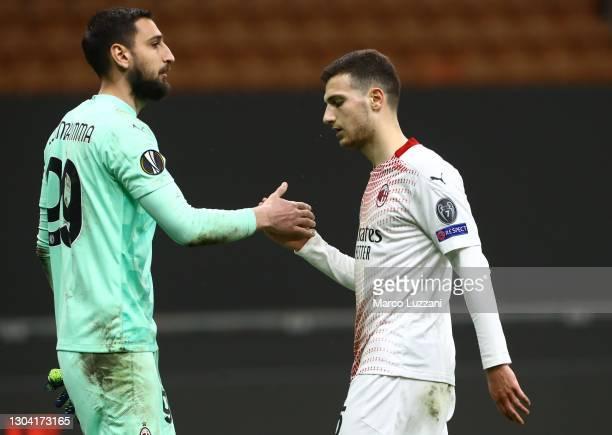 Gianluigi Donnarumma and Diogo Dalot of AC Milan celebrate following the UEFA Europa League Round of 32 match between AC Milan and Crvena Zvezda at...