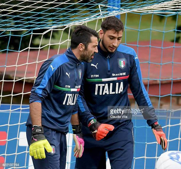 Gianluigi Donnarumma and Gianluigi Buffon chat during the training session at the club's training ground at Coverciano on November 10 2016 in...