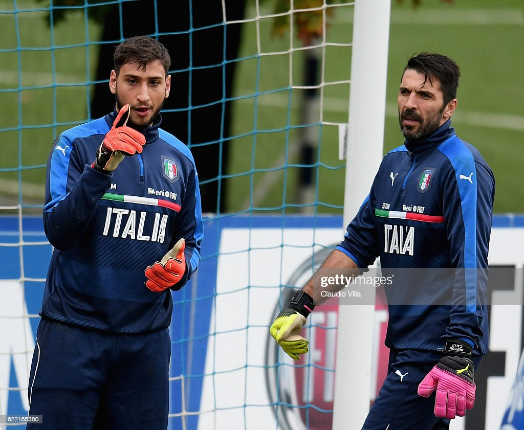 Gianluigi Donnarumma and Gianluigi Buffon (R) chat during the training session at the club's training ground at Coverciano on November 10, 2016 in Florence, Italy.