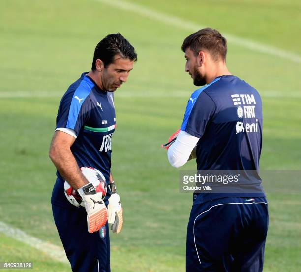 Gianluigi Donnarumma and Gianluigi Buffon of Italy chat during the traning session at Coverciano on August 30 2017 in Florence Italy