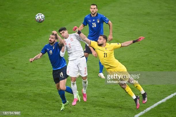 Gianluigi Donnarumma and Leonardo Bonucci of Italy compete for the ball with Alvaro Morata of Spain during the UEFA Euro 2020 Championship Semi-final...