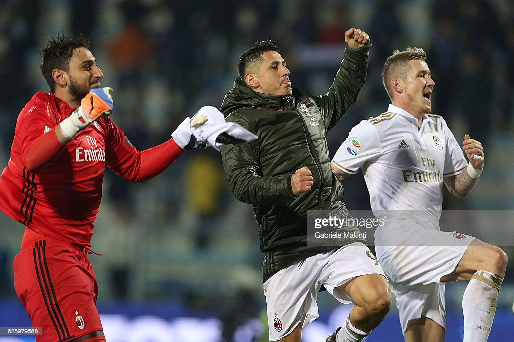 Gianluigi Donnarumma , Gianluca Lapadula and Juraj Kucka of AC Milan celebrates after the game during the Serie A match between Empoli FC and AC Milan at Stadio Carlo Castellani on November 26, 2016 in Empoli, Italy.