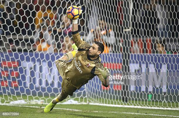 Gianluigi Donnarumma Goalkeeper of AC Milan saving the ball from Juventus FC's Penalty during the Supercoppa TIM Doha 2016 match between Juventus FC...