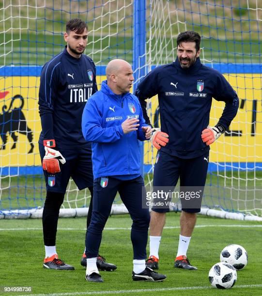 Gianluigi Donnarumma, head coach Italy Luigi Di Biagio and Gianluigi Buffon chat during a Italy training session at Centro Tecnico Federale di...