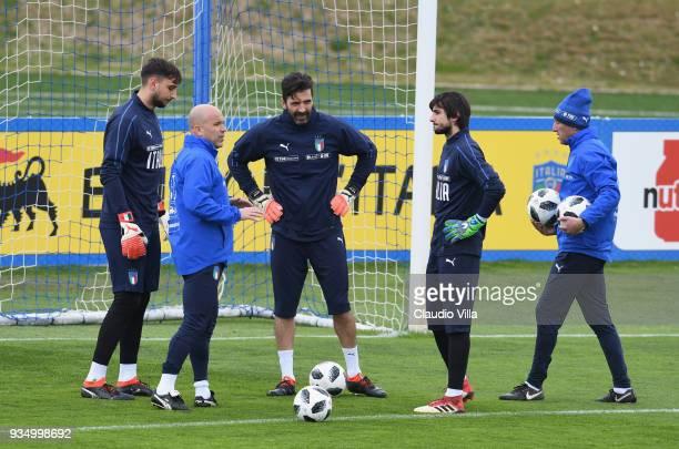 Gianluigi Donnarumma, head coach Italy Luigi Di Biagio, Gianluigi Buffon, Mattia Perin and goalkeeper coach Gianluca Spinelli chat during a Italy...