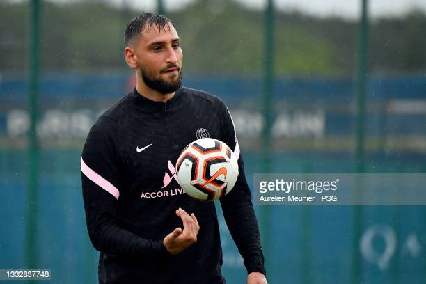 Gianluigi Donnarumma looks on during a Paris Saint-Germain training session at Ooredoo center on August 07, 2021 in Paris, France.