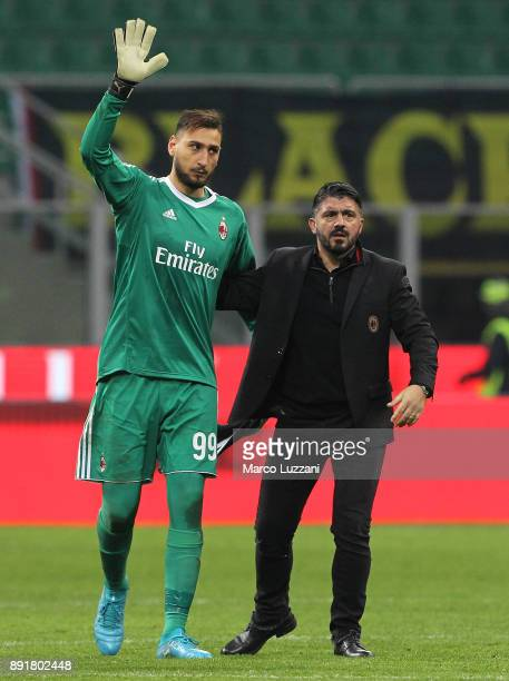 Gianluigi Donnarumma of AC Milan and AC Milan coach Gennaro Gattuso salute the crowd at the end of the Tim Cup match between AC Milan and Hellas...