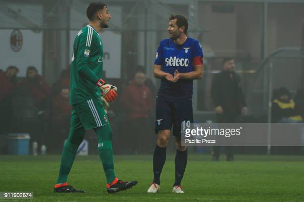 Gianluigi Donnarumma of AC Milan and Senad Lulic of SS lazio during Serie A football AC Milan versus SS Lazio Ac Milan wins 21