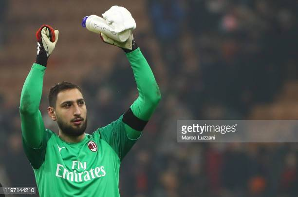 Gianluigi Donnarumma of AC Milan celebrates a victory at the end of the Coppa Italia Quarter Final match between AC Milan and Torino at San Siro on...