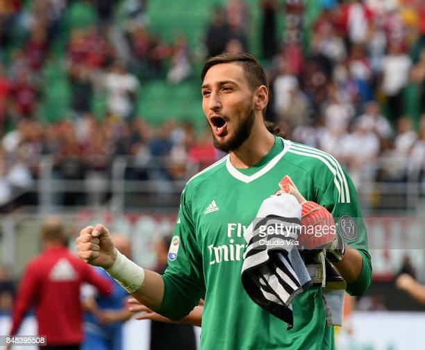 Gianluigi Donnarumma of AC Milan celebrates at the end of the Serie A match between AC Milan and Udinese Calcio at Stadio Giuseppe Meazza on...